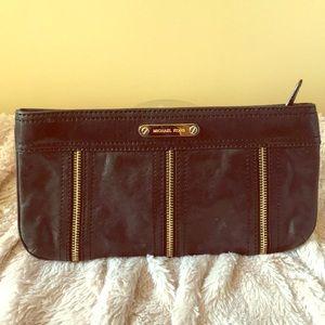 Black clutch with gold zipper detail